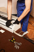 Air conditioning master preparing to install new air conditioner — Stock Photo
