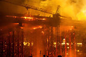 Fire at bridge construction site — Stock Photo
