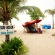 "Stock Photo: BALI- DECEMBER 28: Legian's beach. sign ""Surf lesson & ding repa"