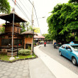 BALI- DECEMBER 28: Taxi car rides down the street. Legian's area — Stock Photo