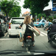 BALI - JANUARY 4 : Tourist with surfboards on scooter on JANUAR — Stock Photo