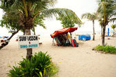 "BALI- DECEMBER 28: Legian's beach. sign ""Surf lesson & ding repa — Stock Photo"
