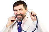 Portrait of happy middle-aged doctor with a stethoscope listenin — Stock Photo