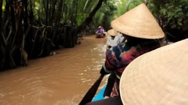 MEKONG DELTA, VIETNAM - JULY 24: woman rows a boat on a canal, — Stock Video