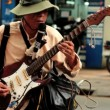 Blind street artist plays guitar — Stock Video #33830085