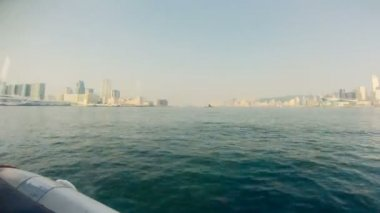 A ferry sails through Victoria Harbour in Hong Kong. Timelapse. — Stockvideo