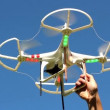 Quadrocopter flying overhead against a blue sky — Stock Video