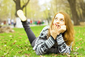 Girl on a green lawn — Stock Photo