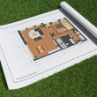 Floor plan in grass — Stock Photo