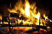 Cozy blazing fire in fireplace — Stock Photo