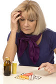 Senior health and medicine-woman having a headache — Stock Photo