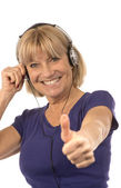 Senior woman 50-60years listening to music with stereo headphone — Stock Photo