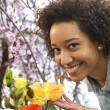 Consumerism: Woman smelling fresh flowers. — Stock Photo #36248081