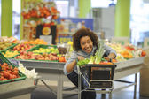 Woman buys vegetable and food in the supermarket — Stock Photo