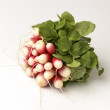Stock Photo: Fresh red radish with green leaf