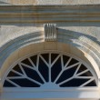 Stock Photo: Door with glass tympanum