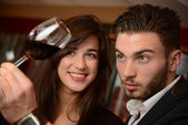 Young couples with redwine glasses at celebration or party — Stock Photo