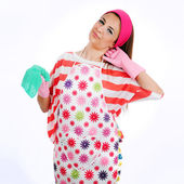 The tired housewife cleaning — Stock Photo