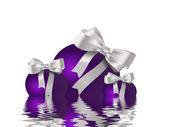 Purple ribbon and bauble inspired Christmas card — Stock Photo