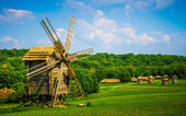 Field with windmill — Stockfoto