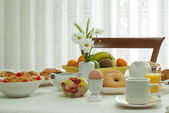 Full breakfast relaxing at home — Stock Photo