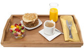 Breakfast tray with milk coffee and crepes — Stock Photo