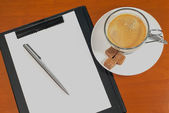 Blank notebook with pen and coffee — Stock fotografie
