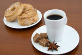 Coffee cup and puff pastry — Stock Photo