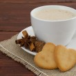 Cream coffee with cookie hearts — Stock Photo #26980737