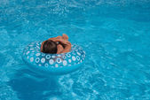 Swimming boy in blue water — Stock Photo