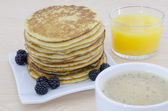 Breakfast table with pancakes — Stock Photo