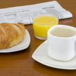 Breakfast with newspaper — Stock Photo #32976221