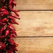 Stock Photo: Chilli Peppers on Wood