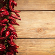 Chilli Peppers on Wood - Stock Photo