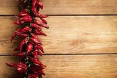 Chilli Peppers on Wood — Stock Photo