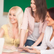 Smiling teacher with two of her students. — Stock Photo