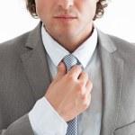 Businessman Tightening His Tie — Stock Photo
