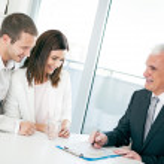 Couple with Financial Advisor — Stock Photo
