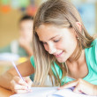 Schoolgirl Writing — Stock Photo