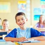 Schoolboy Writing — Stock Photo