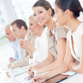Smiling Businesswoman in a Meeting — Stock Photo
