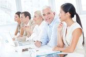 Senior Businessman in a Meeting — Stock Photo