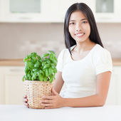 Woman and Plant — Stock Photo