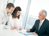 Couple with Financial Advisor — Stock Photo