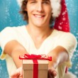 Man Holding a Christmas Present — Stock Photo