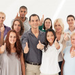 Foto Stock: Multi-Ethnic Group Thumbs Up