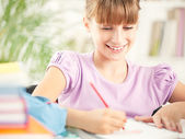Cute Girl Writing Homework — Stockfoto