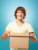 Man Holding a Box — Stock Photo
