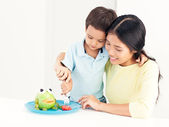 Mother and Son Eating — Stock Photo