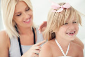Mother Combing Daughter's Hair — Stock Photo